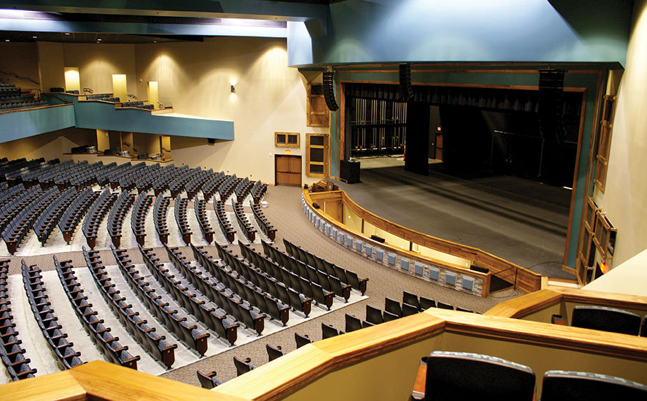 Photo of theater stage and seating.
